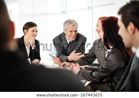 Happy high school student posing in classroom with his friends in background - stock photo