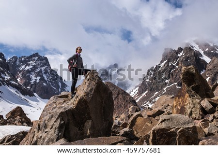 Happy hiker enjoying the view, achievement in mountains