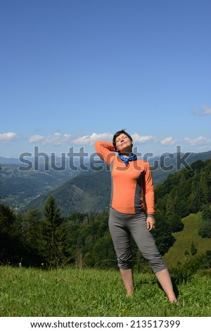 Happy hiker on a sunny day  - stock photo