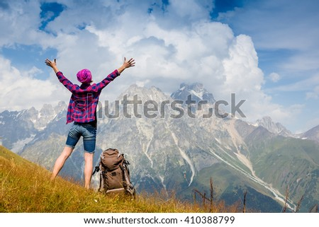 Happy hiker with her arms outstretched, freedom and happiness, achievement in mountains  - stock photo