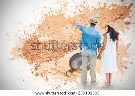 Happy hipster couple holding hands and looking against world map with compass showing north america - stock photo