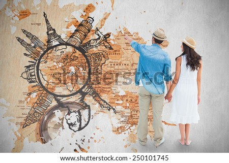 Happy hipster couple holding hands and looking against world map with compass showing southern asia - stock photo