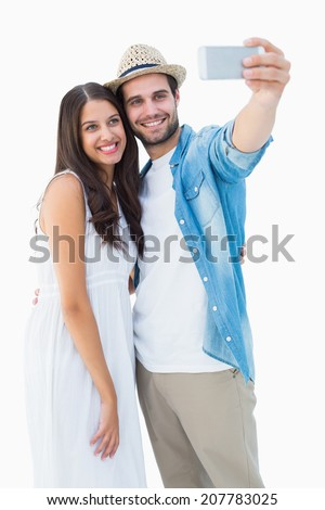 Happy hipster couple taking a selfie on white background - stock photo