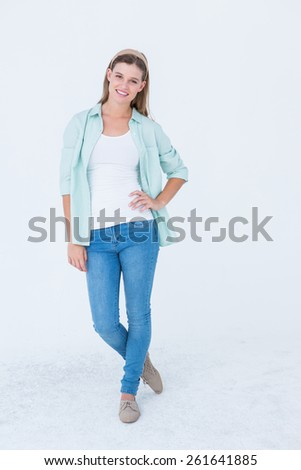 Happy hipster smiling at camera on white background - stock photo