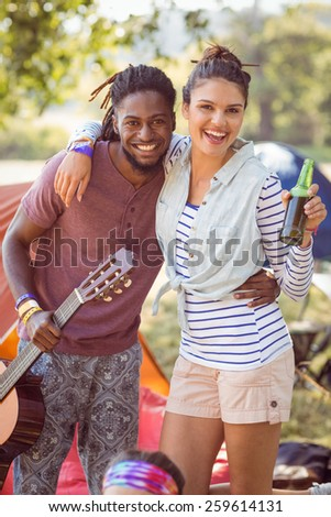 Happy hipsters having fun on campsite at a music festival - stock photo