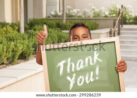 Happy Hispanic Boy Giving Thumbs Up Holding Thank You Chalk Board Outside on School Campus. - stock photo