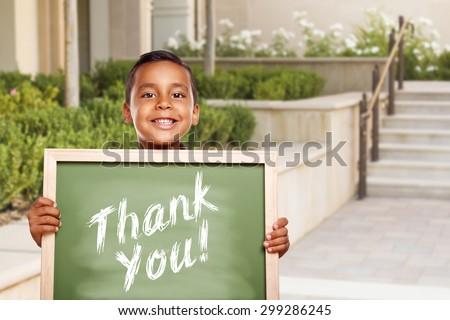 Happy Hispanic Boy Holding Thank You Chalk Board Outside on School Campus. - stock photo