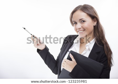 Happy hispanic business woman pointing towards copy space - stock photo