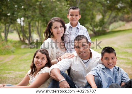 Happy Hispanic Family Portrait In the Park.