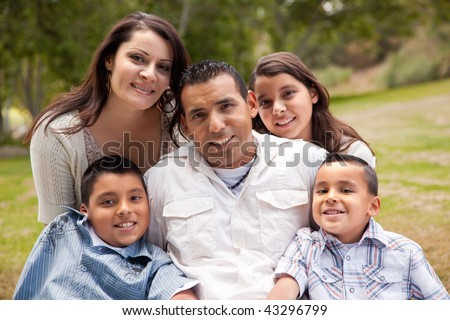 Happy Hispanic Family Portrait In the Park. - stock photo
