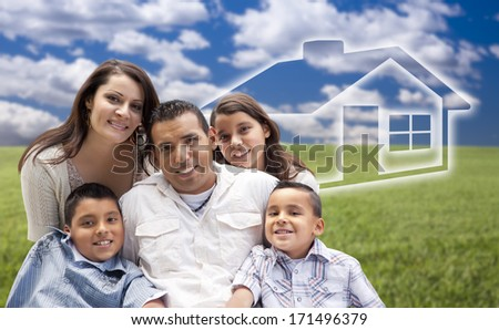 Happy Hispanic Family Portrait Sitting in Grass Field with Ghosted House Figure Behind. - stock photo