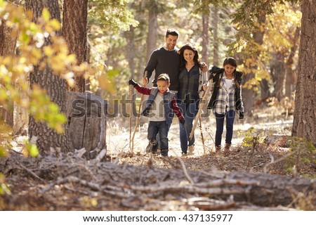 Happy Hispanic Family Two Children Walking Stock Photo 437135977