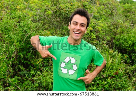 Happy hispanic volunteer wearing a green recycling shirt - stock photo