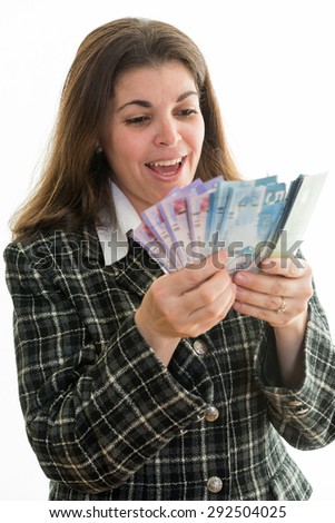 Happy Hispanic woman counting Canadian dollars. Successful business woman in Canada's multicultural society. White background. Enjoying the fact of having money - stock photo