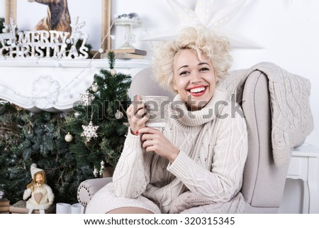 Happy holiday blonde beautiful woman. Merry Christmas! Happy New Year. Series of winter holiday photos. - stock photo