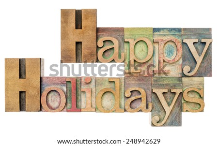 Happy Holidays - isolated text in letterpress wood type printing blocks stained by color inks - stock photo
