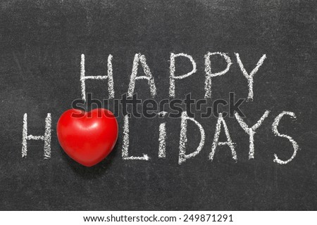 happy holidays phrase handwritten on blackboard with heart symbol instead of O