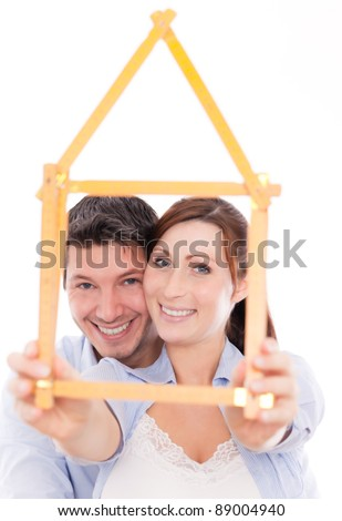 happy home planning couple isolated - stock photo