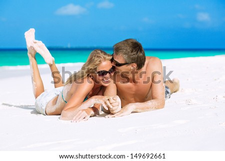 Happy honeymooners enjoying their vacation on Maldives - stock photo