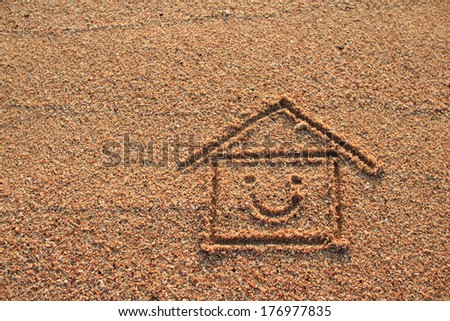 Happy house and smile icon drawn on beach sand - stock photo