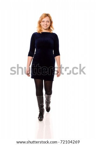 Happy Housewife walking over white background - stock photo