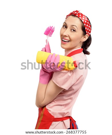 Happy housewife with cleaning supplies. Isolated on white background. - stock photo