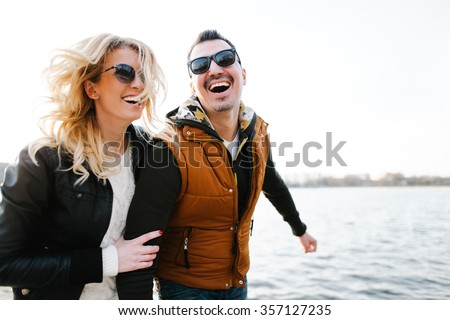 Happy In love couple smiling and hugging eachother outdoor  - stock photo