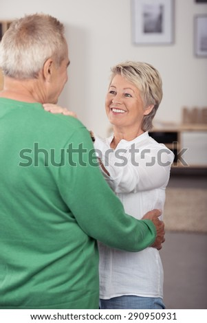Happy In Love Middle Aged Couple Dancing So Sweet While Looking Each Other in Living Room. - stock photo