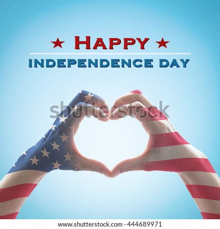 Happy independence day 4th of July text message: National America flag pattern on people hands in heart shaped on blue sky background: United states of america USA labor, US holiday day concept - stock photo
