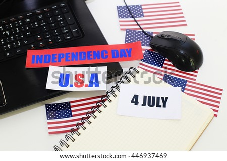 Happy Independence Day with cards of flag on notebook computer