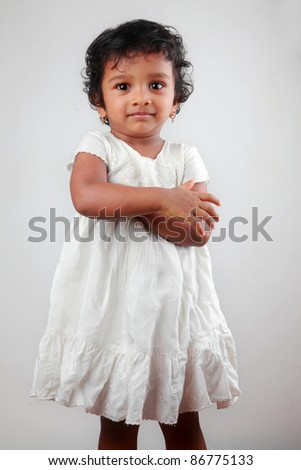Happy Indian baby girl in white dress - stock photo