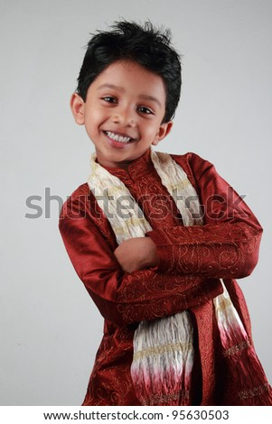 Happy Indian boy wearing  traditional dress - stock photo