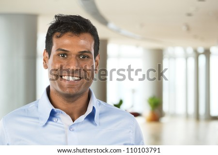 Happy Indian business man at the office. - stock photo