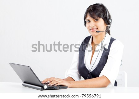 happy indian call center operator with headset - stock photo