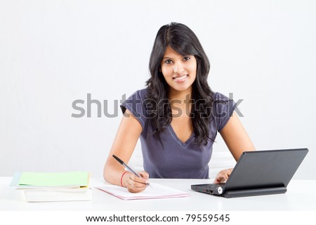 happy indian college student studying