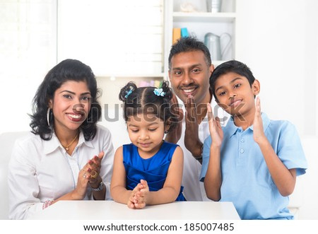 happy indian family indoor portrait - stock photo