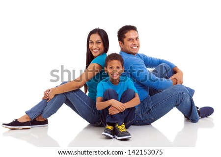 happy indian family sitting on the floor isolated on white - stock photo