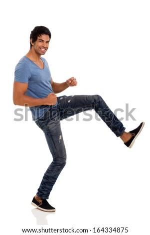 happy indian man posing on white background - stock photo