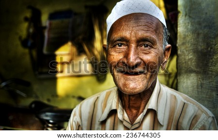 Happy Indian man smiling for the camera. - stock photo