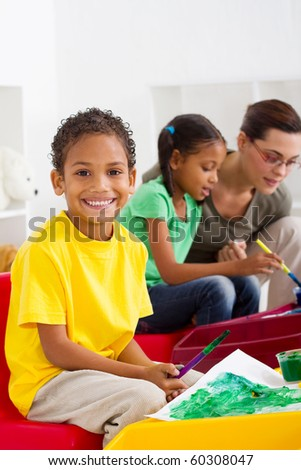 happy Indian preschool boy in classroom - stock photo