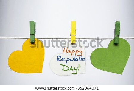 Happy Indian Republic Day 26 January concept. India flag (heart color) hanging on pegs ( clothespin ) on white.  - stock photo