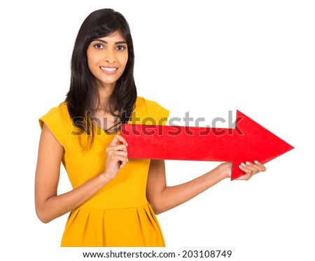 happy indian woman holding red direction arrow on white background - stock photo
