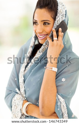 happy indian woman in saree talking on smart phone - stock photo