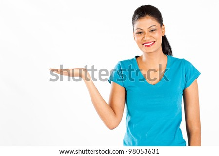 happy indian woman presenting on white background - stock photo