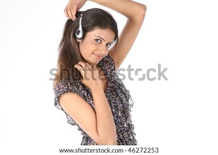 Happy indian woman with headphones - stock photo