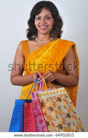 Happy Indian woman with shopping bags in  traditional dress sari - stock photo