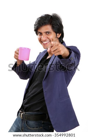 Happy Indian young man with coffee cup on white background. - stock photo