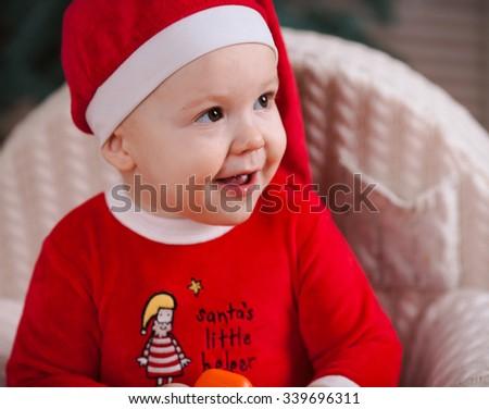 Happy infant baby boy in santa costume closeup - stock photo