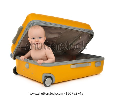 Happy infant baby toddler sitting in yellow plastic travel suitcase on wheels getting ready for vacation isolated on a white background - stock photo