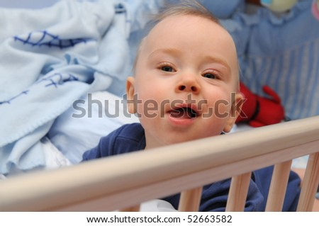 Happy infant in a cradle